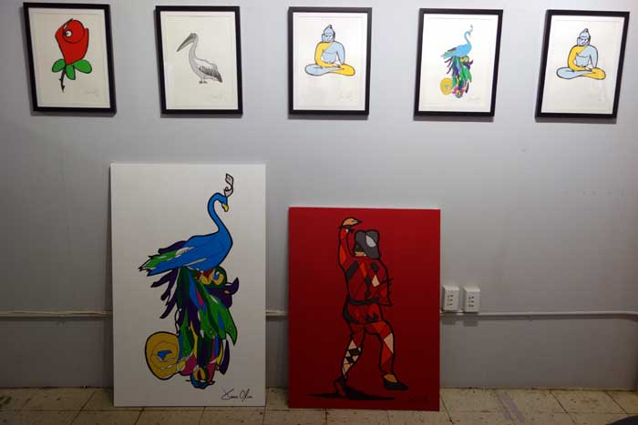 Peacock and Harlequin paintings by Jason Oliva alongside works on paper of Rose, Pelican, Buddha and Peacock